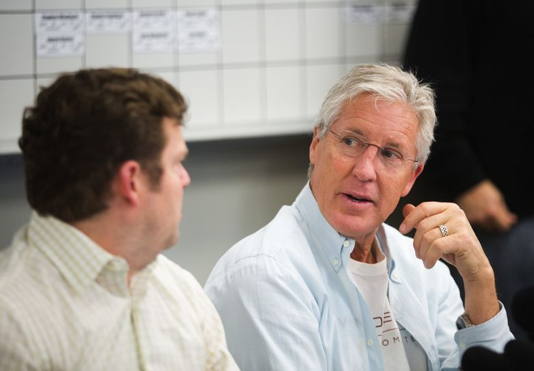 Seahawks coach Pete Carroll, right, turns to general manager John Schneider as they answer reporters' questions after the close of the 2016 NFL draft at the Virginia Mason Athletic Center in Renton on Saturday, April 30, 2016. (Lindsey Wasson / The Seattle Times, file)