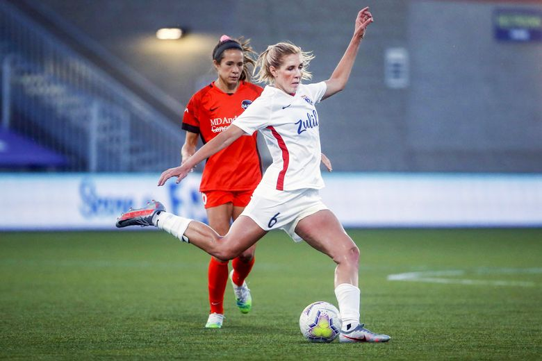OL Reign midfielder Allie Long clears the ball during a NWSL Challenge Cup match at Zions Bank Stadium in Herriman, Utah in 2020. (Rick Bowmer / AP, file)