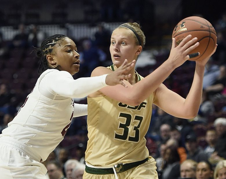 South Florida's Kitija Laksa, right, looks to pass while being defending by Temple's Tanaya Atkinson during the American Athletic Conference tournament semifinals in 2017. (Jessica Hill / AP)