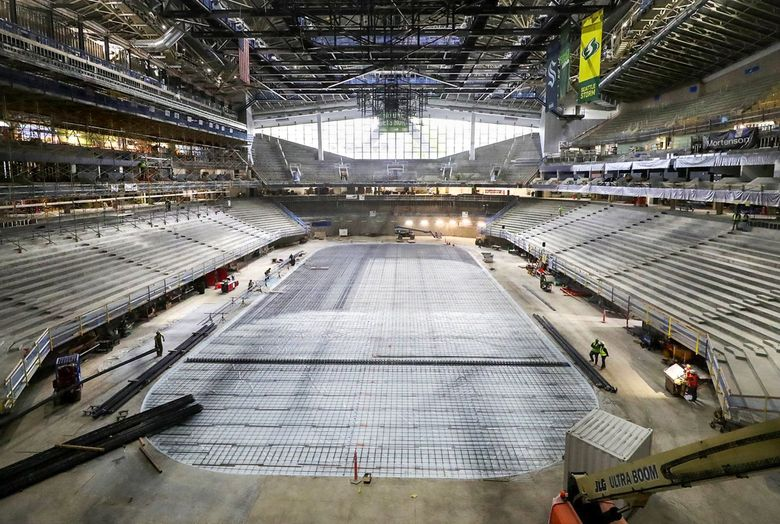 Steel rebar seen in the process of being installed on the floor inside Climate Pledge Arena, April 23, 2021. (Greg Gilbert / The Seattle Times)