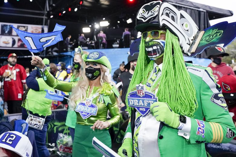 Seattle Seahawks fans attend the first round of the 2021 NFL draft, Thursday, April 29, 2021, in Cleveland. The Seahawks have did not have a first round pick, their first draft selection is slotted at number 24, 56th overall, on day two of the draft. (Tony Dejak / AP)