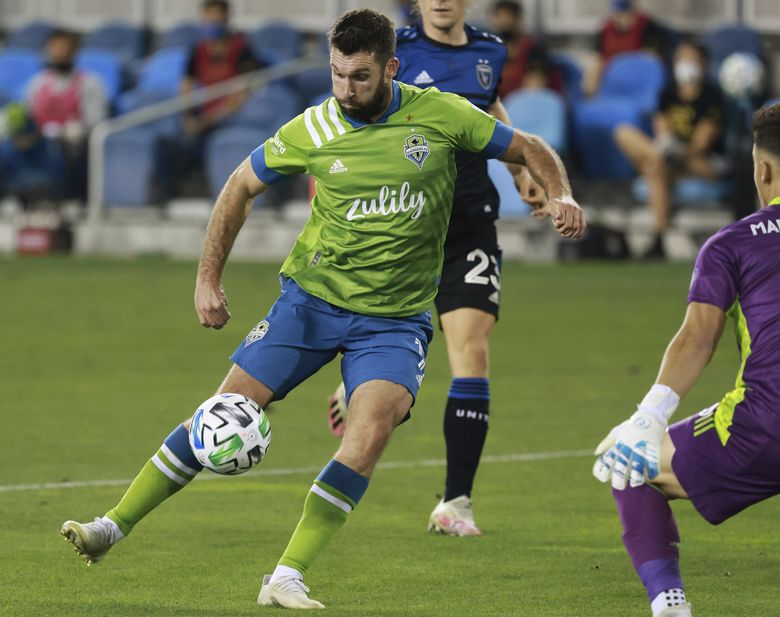 Seattle Sounders forward Will Bruin (17) takes a shot against San Jose Earthquakes goalkeeper JT Marcinkowski (18) during the second half of an MLS soccer match, Sunday, Oct. 18, 2020, in San Jose, Calif. (Josie Lepe / AP)