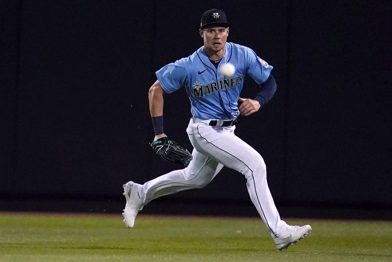 Seattle Mariners center fielder Jarred Kelenic chases a ground ball hit for a single by Chicago White Sox's Danny Mendick during the second inning of a spring training baseball game Friday, March 19, 2021, in Peoria, Ariz. Mendick was out at second base on the throw by Kelenic. (AP Photo/Sue Ogrocki) (Sue Ogrocki / AP)