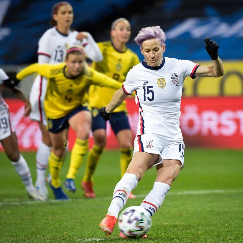 Megan Rapinoe of USA scores a goal on a penalty kick during the women's international friendly soccer match between Sweden and USA at Friends Arena in Stockholm, Sweden, Saturday, April 10, 2021. (Janerik Henriksson/TT via AP) — LOPH109 (Janerik Henriksson / AP)
