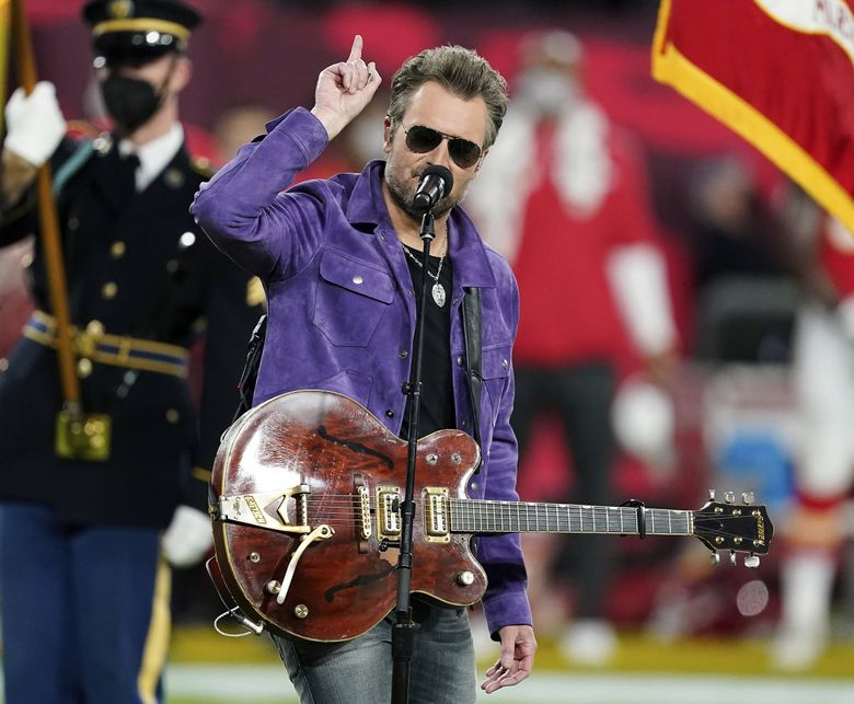 Eric Church, seen performing the national anthem with Jazmine Sullivan before the Super Bowl on Feb. 7, is scheduled to play an Oct. 30 concert at Climate Pledge Arena. (Steve Luciano / The Associated Press, file)