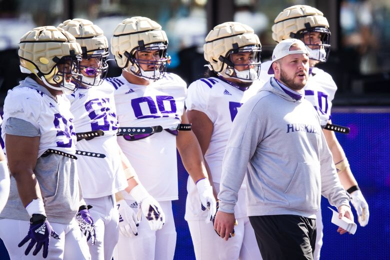 Defensive line coach Rip Rowan works with his unit as the University of Washington Huskies participate in spring practice at Husky Stadium Saturday April 17, 2021 in Seattle. (Bettina Hansen / The Seattle Times)