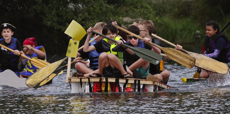 Boy Scout Troop 520 gets off to a fast start at the 2016 Seafair Milk Carton Derby on Green Lake. This year there will be no in-person event, but fans of the race are invited to build a milk-carton boat at home and share their creation for a chance to win prizes. (Alan Berner / The Seattle Times, file)