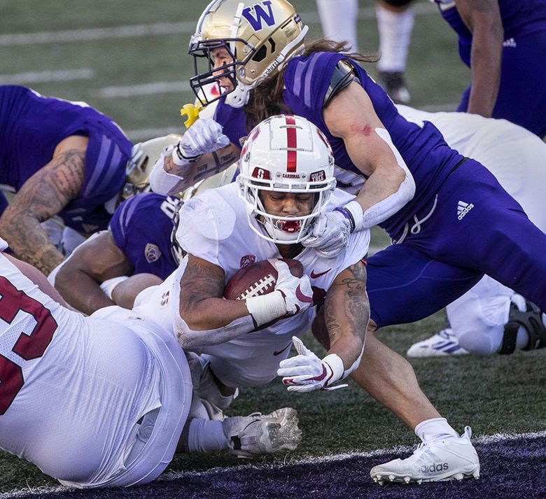 Washington can't keep Stanford's Austin Jones out of the end zone, scoring for the Cardinal in the 1st quarter.  The Stanford University Cardinals played the University of Washington in Pac-12 Football Saturday, December 5, 2020 at Husky Stadium in Seattle, WA. (Dean Rutz / The Seattle Times)
