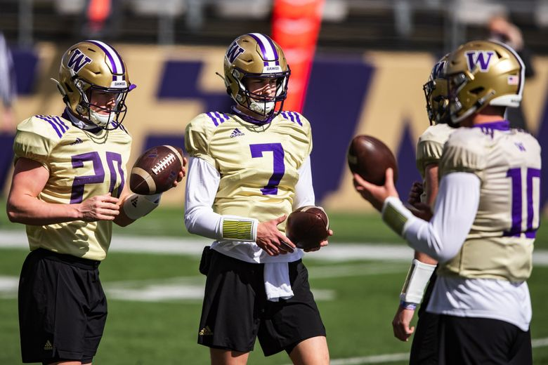Quarterbacks from left, Camden Sirmon, Sam Huard, Dylan Morris and Patrick O'Brien work out as the University of Washington Huskies participate in their spring practice at Husky Stadium Saturday April 10, 2021 in Seattle. (Bettina Hansen / The Seattle Times)