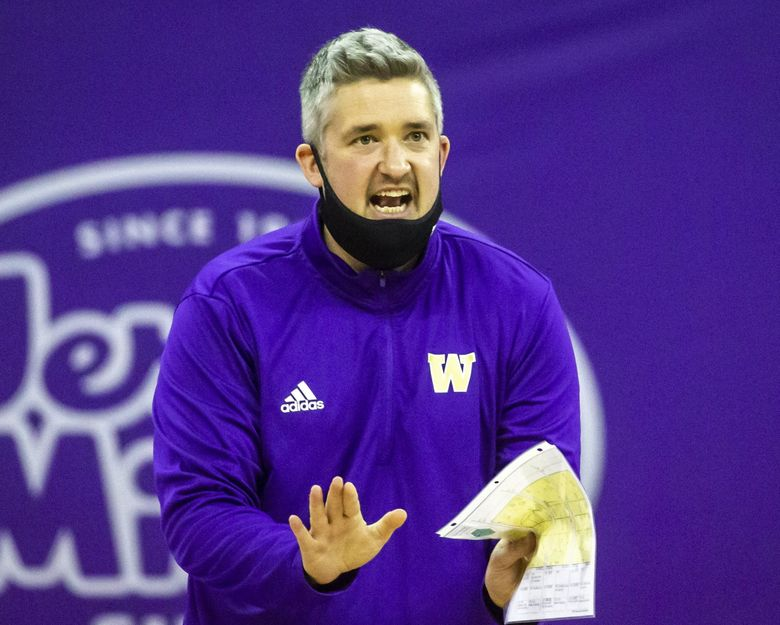 Washington head coach Keegan Cook talks to his players on the court as the University of Washington Huskies take on the Stanford Cardinal for their final home volleyball game of the season at Alaska Airlines Arena in Seattle Sunday March 28, 2021. (Bettina Hansen / The Seattle Times)