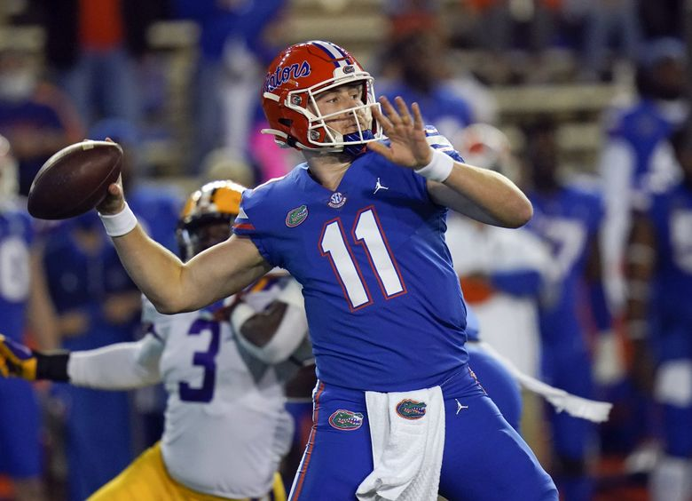 Florida quarterback Kyle Trask (11) throws a pass as LSU linebacker Andre Anthony (3) rushes during the first half of an NCAA college football game Saturday, Dec. 12, 2020, in Gainesville, Fla. (John Raoux / AP)