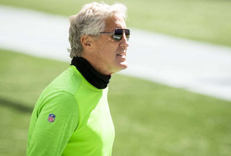 Seahawks head coach Pete Carroll walks the field before the Seattle Seahawks hold a mock game at CenturyLink Field in Seattle on Aug. 22, 2020. (Bettina Hansen / The Seattle Times)