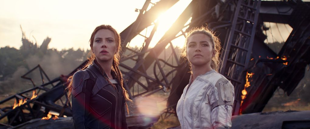 """Natasha Romanoff (Scarlett Johansson, left) and Yelena (Florence Pugh) carry the torch for the Marvel Cinematic Universe in Marvel's """"Black Widow,"""" in theaters this summer. (Courtesy of Marvel Studios)"""