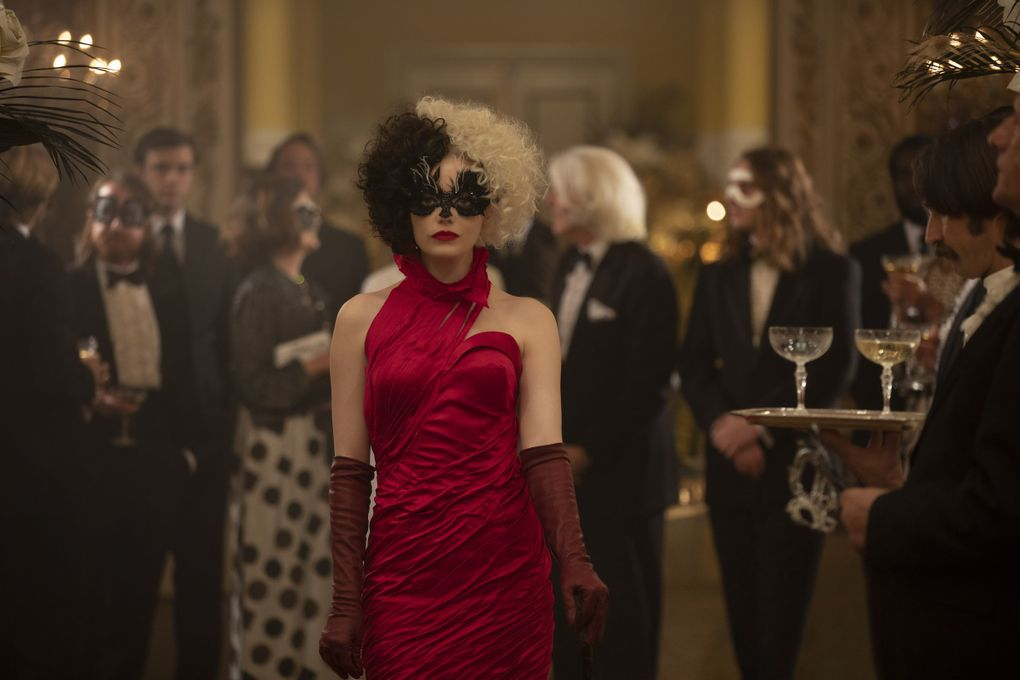 """Emma Stone, who is always delightful, takes a turn as the title character in Disney's live-action movie """"Cruella."""" (Laurie Sparham / Disney)"""