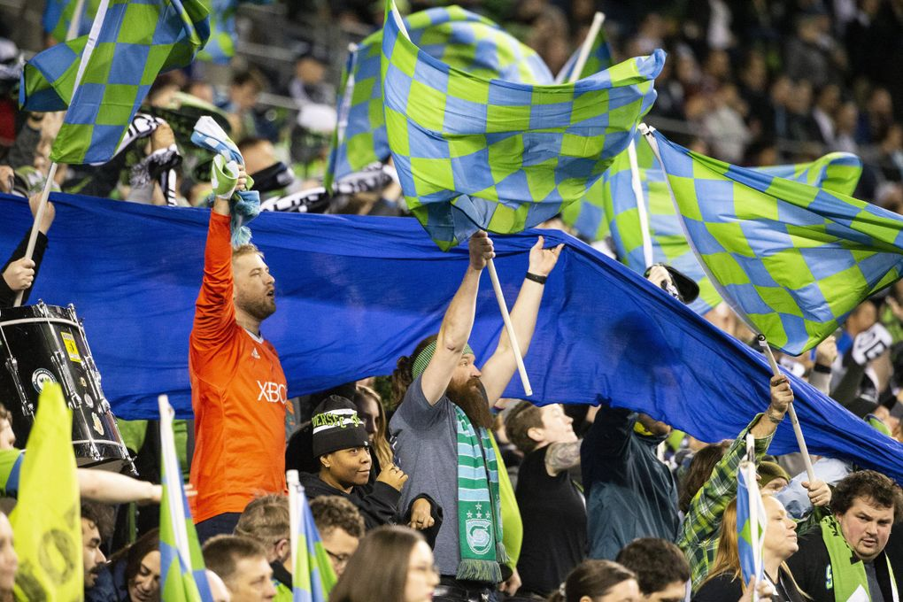 Seattle Sounders fans cheer against CD Olimpia in the CONCACAF Champions League at CenturyLink Field on Thursday, Feb. 27, 2020.  (Amanda Snyder / The Seattle Times)