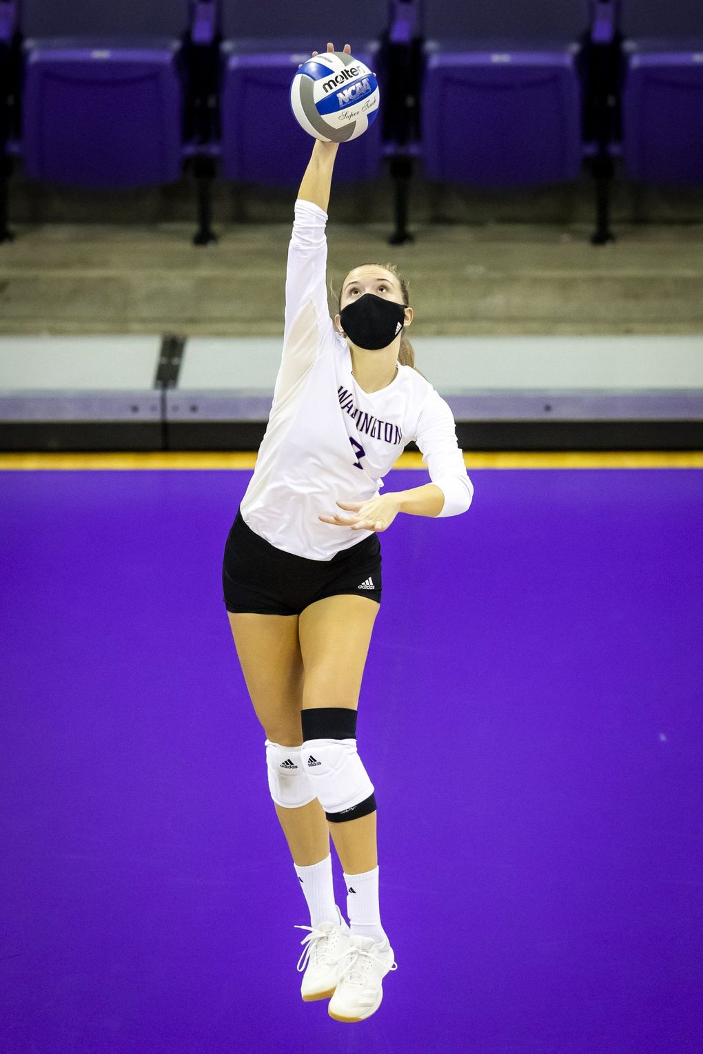 Washington setter Ella May Powell serves as the University of Washington Huskies take on the Oregon State Beavers for a volleyball game Saturday February 6, 2021 at Alaska Airlines Arena in Seattle. (Bettina Hansen / The Seattle Times)