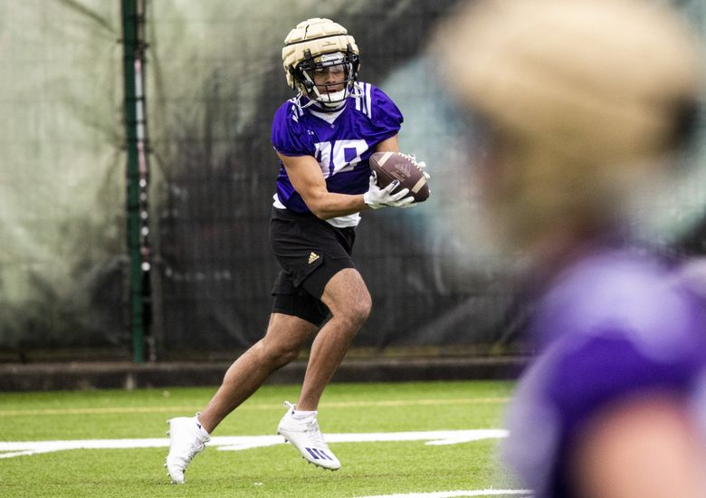 Tight end Quentin Moore (88) catches the ball in a drill during spring practice at the east practice field on Wednesday, April 7, 2021. (Amanda Snyder / The Seattle Times)