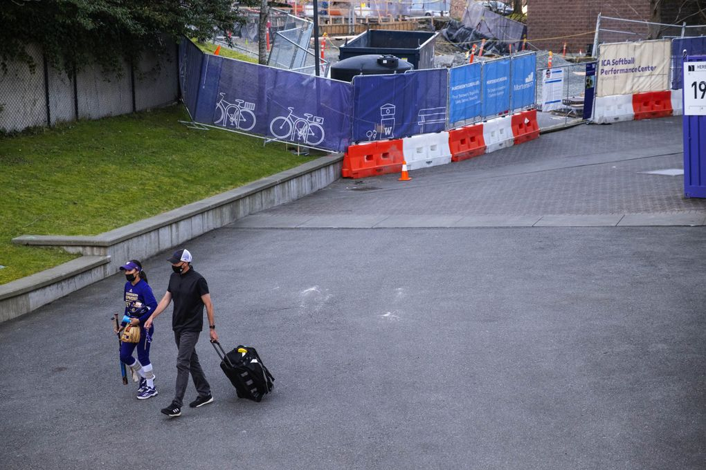 Athletic trainer Rob Scheidegger heads over to Husky Softball Stadium with the team for Friday's game against Seattle University.  (Dean Rutz / The Seattle Times)