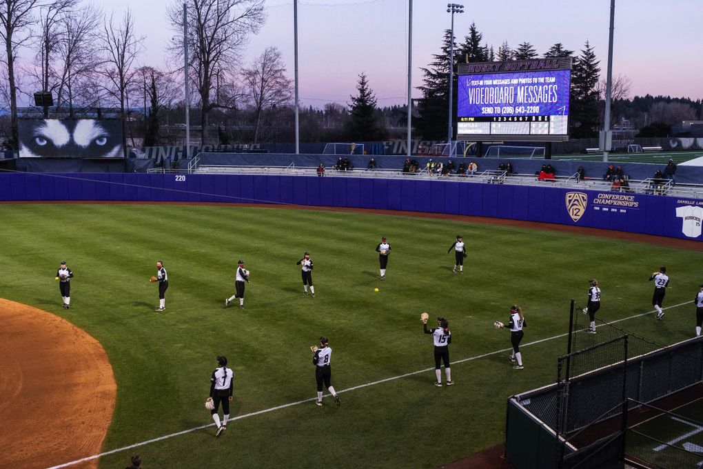 The Husky Softball diamond is made ready to play for a game on Friday, March 12 — one year after COVID-19 shut down athletics everywhere. (Dean Rutz / The Seattle Times)