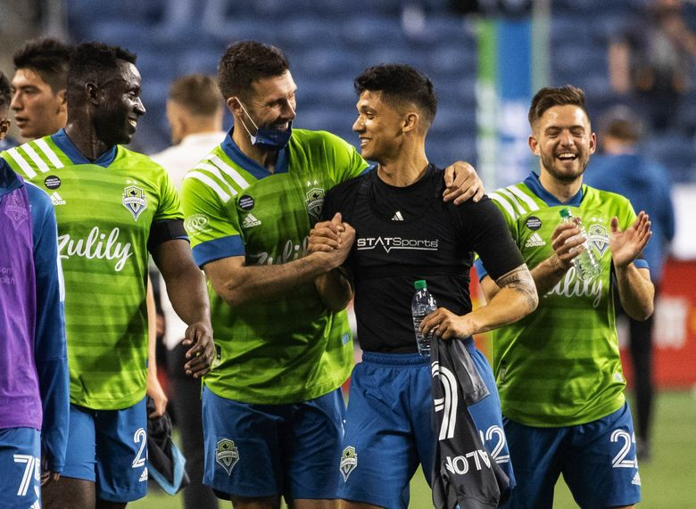 Will Bruin congratulates Fredy Montero after Friday's game.  Minnesota United FC played the Seattle Sounders FC in the Major League Season opener Friday, April 16, 2021 at Lumen Field in Seattle, WA. (Dean Rutz / The Seattle Times)