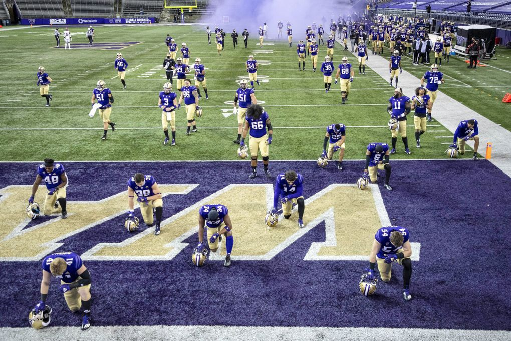 Washington comes out ffor its game with Utah Saturday.  The University of Utah played the Washington Huskies in Pac-12 Football November 28, 2020 at Husky Stadium. (Dean Rutz / The Seattle Times)