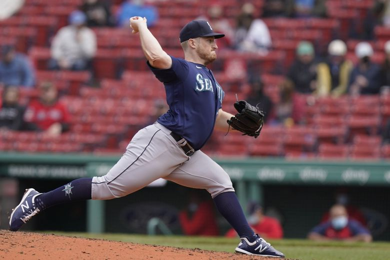 Mariners relief pitcher Ljay Newsome (74) winds up for a pitch in the fifth inning against the Red Sox on Sunday.(Steven Senne / The Associated Press)