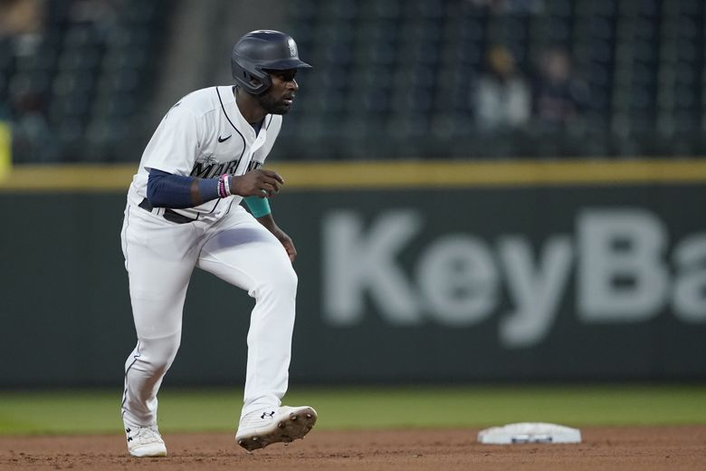 Seattle Mariners' Taylor Trammell leads off second after hitting an RBI-double to score Evan White during the fourth inning of a baseball game against the San Francisco Giants, Saturday, April 3, 2021, in Seattle. (Ted S. Warren / The Associated Press)