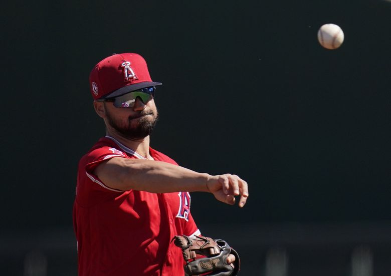Los Angeles Angels shortstop Jack Mayfield throws the ball to a teammate during the first inning of a spring training baseball game against the Cleveland Indians Wednesday, March 10, 2021, in Goodyear, Ariz. (Ross D. Franklin / AP)