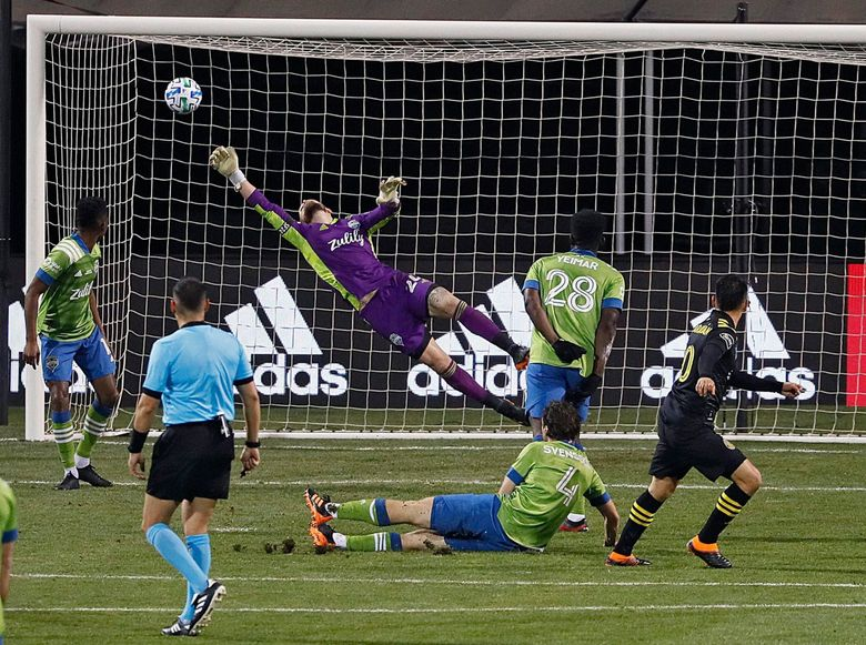 Crew SC midfielder Lucas Zelarayan, right, watches as his shot sails over the outstretched arm of Seattle Sounders goalkeeper Stefan Frei for his second goal of the game, as Columbus rolled to a 3-0 victory in the MLS Cup final on Dec. 12 at Mapfre Stadium. (Kyle Robertson/Columbus Dispatch / TNS)
