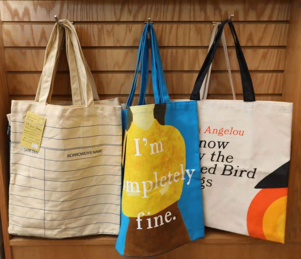 Canvas tote bags are for sale at Brick & Mortar Books, a family-owned indie bookseller in Redmond that has served the local community for nearly four years. (Ken Lambert / The Seattle Times)