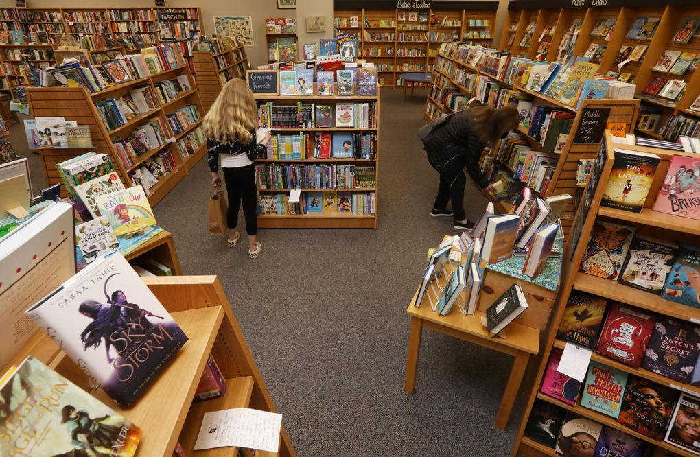Customers browse at Brick & Mortar Books April 14, 2021, in Redmond. The store has become a popular spot in this suburb made famous by tech companies like Microsoft. (Ken Lambert / The Seattle Times)