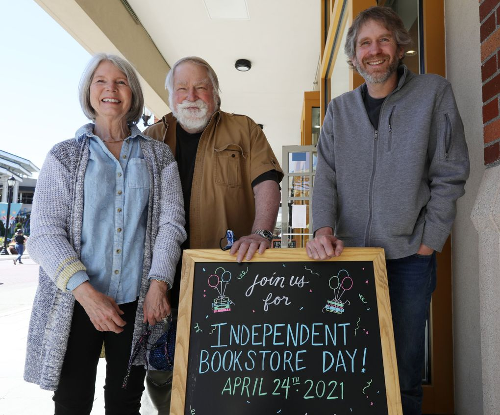 Dan Ullom, right, along with his parents Tina and John Ullom, are co-owners of Brick & Mortar Books in Redmond Town Center. Without bookselling experience, the family opened the indie bookstore almost four years ago. (Ken Lambert / The Seattle Times)