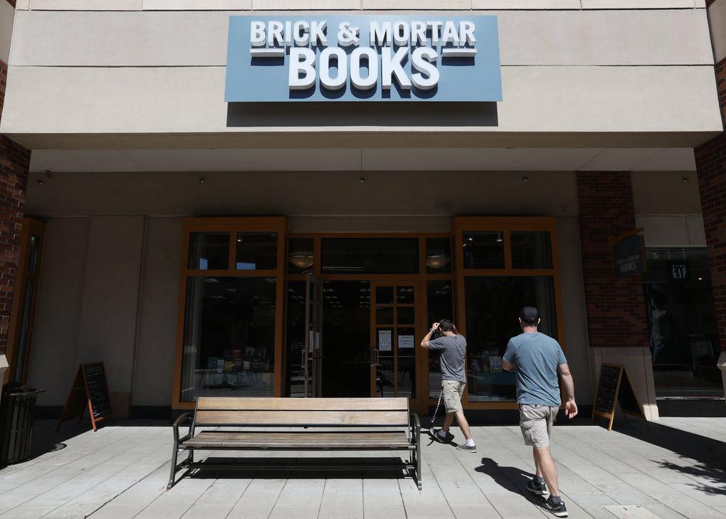 Customers walk into Brick & Mortar Books, Wednesday, April 14, 2021, in Redmond. (Ken Lambert / The Seattle Times)