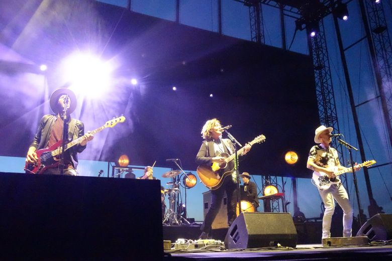 Brandi Carlile, center, performs with Phil Hanseroth, left, and Tim Hanseroth at the Gorge Amphitheatre in 2019. The Gorge is among more than 60 venues expected to get livestreaming technology from VEEPS. (Michael Rietmulder / The Seattle Times, file)
