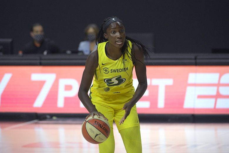 Storm center Ezi Magbegor sets up a play during the second half of Game 2 of basketball's WNBA Finals against the Las Vegas Aces in October. (Phelan M. Ebenhack / AP)