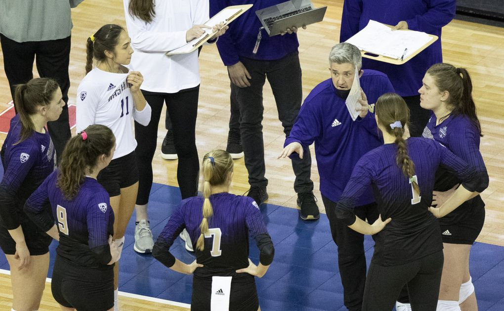 Washington volleyball coach Keegan Cook, center right, speaks to the Huskies during a timeout against Kentucky in the Final Four of the NCAA tournament Thursday night. (Rebecca S. Gratz / Rebecca S. Gratz)