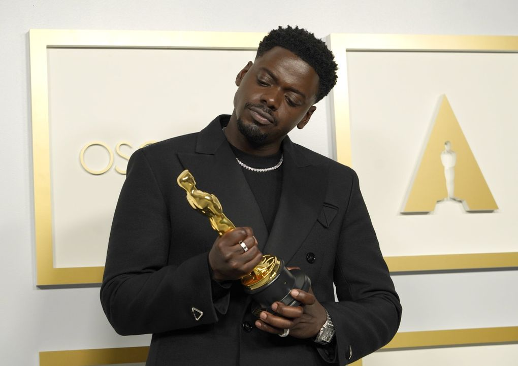"""Daniel Kaluuya, winner of the award for best actor in a supporting role for """"Judas and the Black Messiah,"""" poses in the press room at the Oscars on Sunday, April 25, 2021, at Union Station in Los Angeles. (AP Photo/Chris Pizzello, Pool) CALB694 CALB694 (Chris Pizzello / The Associated Press)"""