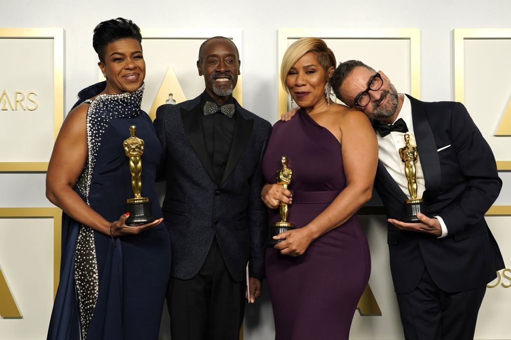 """Don Cheadle, second left, poses with the winners of the award for best makeup and hairstyling for """"Ma Rainey's Black Bottom,"""" Mia Neal, from left, Jamika Wilson and Sergio Lopez-Rivera in the press room at the Oscars on Sunday, April 25, 2021, at Union Station in Los Angeles. (AP Photo/Chris Pizzello, Pool) CALB706 CALB706 (Chris Pizzello / The Associated Press)"""