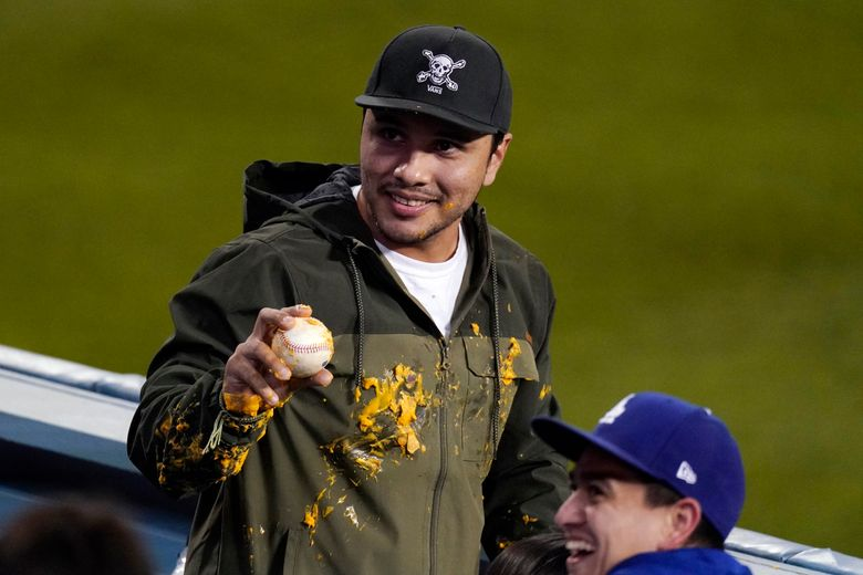 A fan in Los Angeles got a home-run ball from Justin Turner and a hoodie covered in nacho cheese at a game last week. (Mark J. Terrill / AP)