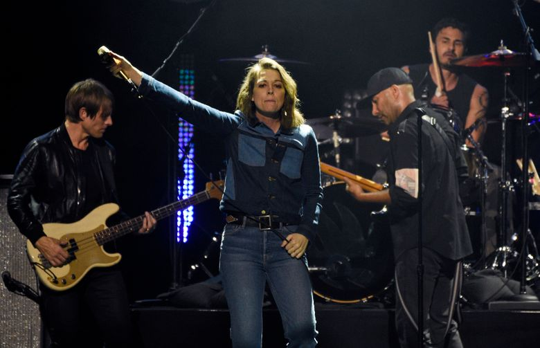 """Brandi Carlile, center, performs with members of Audioslave during """"I Am The Highway: A Tribute to Chris Cornell"""" at The Forum, Jan. 16, 2019, in Inglewood, California. (Chris Pizzello / Invision / The Associated Press)"""