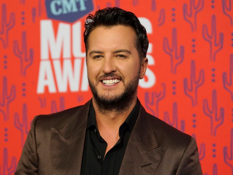 FILE – In this June 5, 2019 file photo, Luke Bryan arrives at the CMT Music Awards at the Bridgestone Arena in Nashville, Tenn. Paula Abdul is set to return as a guest judge on Monday night's first live episode of American Idol replacing Luke Bryan, who announced he tested positive for COVID-19. (AP Photo/Sanford Myers, File)