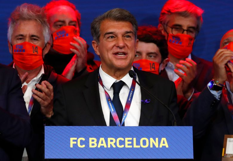 FILE – In this Sunday, March 7, 2021 file photo, Joan Laporta celebrates his victory after elections at the Camp Nou stadium in Barcelona, Spain. Barcelona president Joan Laporta maintained his support for the Super League on Thursday April 22, 2021, despite the quick exit of 10 of the 12 founding clubs in the breakaway competition. (AP Photo/Joan Monfort, File)