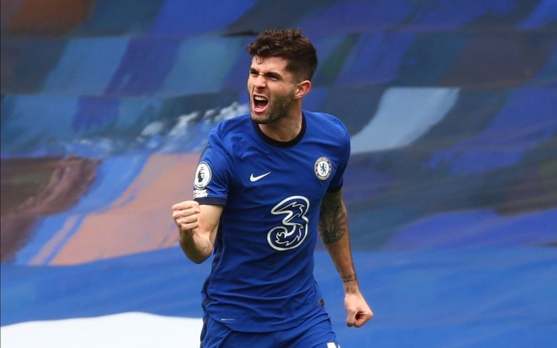 Chelsea's Christian Pulisic celebrates scoring their side's first goal during the English Premier League soccer match between Chelsea and West Bromwich Albion at Stamford Bridge stadium in London, England, Saturday, April 3, 2021.(Clive Rose/Pool via AP)