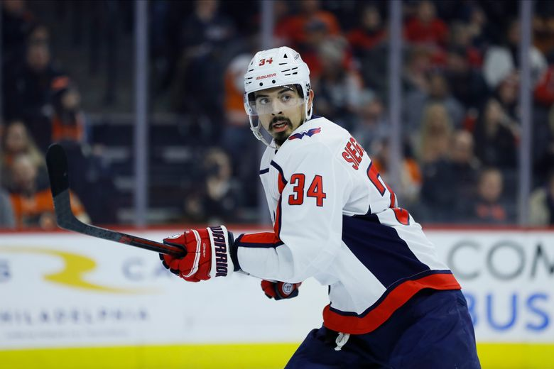FILE – Washington Capitals' Jonas Siegenthaler plays during an NHL hockey game against the Philadelphia Flyers in Philadelphia, in this Wednesday, Jan. 8, 2020, file photo. The New Jersey Devils acquired defenseman Jonas Siegenthaler on Sunday, April 11, 2021, from the Washington Capitals for a 2021 third-round pick.  (AP Photo/Matt Slocum, File)