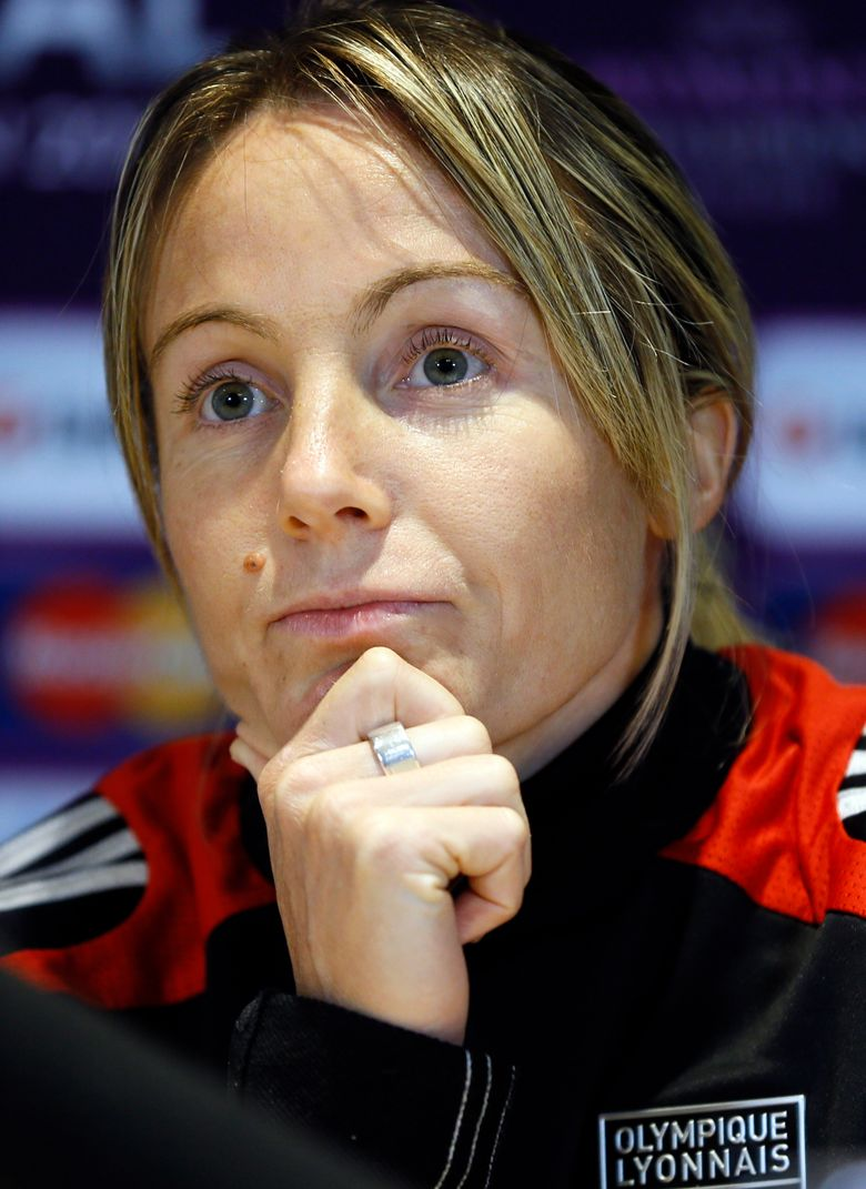 FILE – In this Wednesday, May 22, 2013 file photo Lyon's captain Sonia Bompastor listens during a press conference at Stamford Bridge Stadium in London. Europe's most successful women's soccer team has hired a woman as its coach for the first time with Lyon's appointment of Sonia Bompastor to replace Jean-Luc Vasseur. (AP Photo/Kirsty Wigglesworth, File)