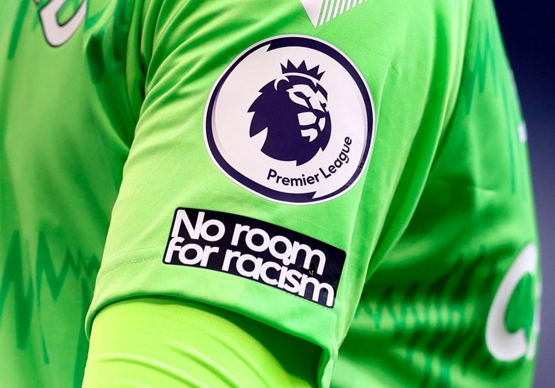 """FILE – This Sunday, Sept. 13, 2020 file photo shows the """"No Room For Racism"""" logo on the shirt of Everton's goalkeeper Jordan Pickford during the English Premier League soccer match between Tottenham Hotspur and Everton at the Tottenham Hotspur Stadium in London. Four days of silence across Twitter, Facebook and Instagram by soccer leagues, clubs and players in England was beginning on Friday April 30, 2021, in a protest against racist abuse that has been adopted more widely. (Cath Ivill/Pool via AP, File)"""