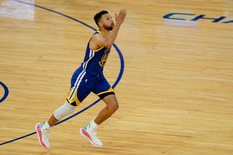 Golden State Warriors guard Stephen Curry (30) gestures after scoring against the Denver Nuggets to pass Wilt Chamberlain to become the franchise's all-time leading scorer during the first half of an NBA basketball game in San Francisco, Monday, April 12, 2021. (AP Photo/Jeff Chiu)
