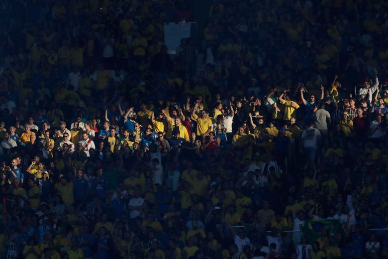 """FILE – In this July 7, 2019 file photo, Brazil soccer fans cheer prior to the final match of the Copa America against Peru at Maracana stadium in Rio de Janeiro, Brazil. On April 13, 2021, CONMEBOL President Alejandro Domínguez confirmed that the 2021 Copa America tournament, hosted by Argentina and Colombia, will be played """"with or without spectators"""" amid the COVID-19 pandemic. (AP Photo/Andre Penner, File)"""