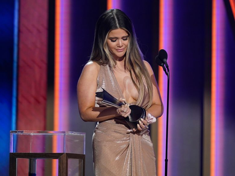 """Maren Morris accepts the award for song of the year for """"The Bones"""" at the 56th annual Academy of Country Music Awards on Sunday, April 18, 2021, at the Grand Ole Opry in Nashville, Tenn. (AP Photo/Mark Humphrey)"""