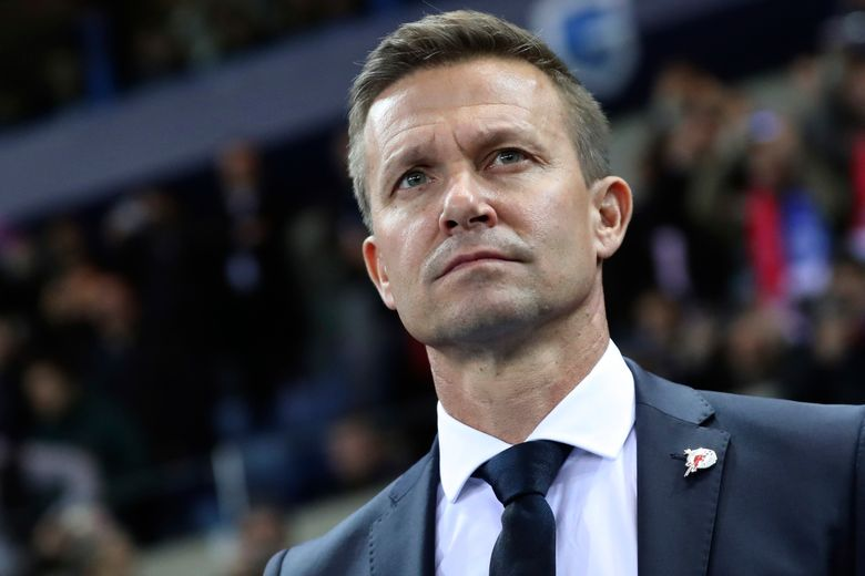 FILE – In this file photo dated Wednesday, Nov. 27, 2019, Salzburg soccer coach Jesse Marsch stands on the sidelines during a Champions League group E soccer match against Genk at the KRC Genk Arena in Genk, Belgium. American coach Jesse Marsch is taking over German soccer team Leipzig next season.  The Bundesliga club said Thursday that Marsch will switch from sister club Red Bull Salzburg on a two-year contract until June 2023.  (AP Photo/Francisco Seco, FILE)